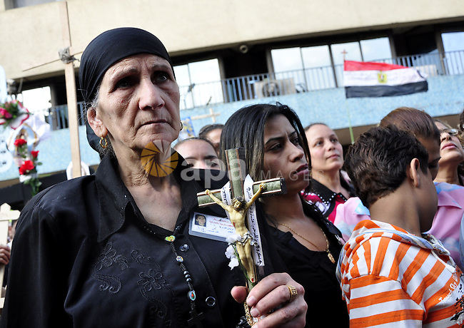 Egyptian Coptic Christians protest in front of the state television building in Cairo on May 14, 2011 against recent attempts to trigger sectarian conflict in the country. Photo by Ahmed Asad
