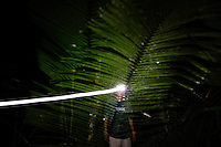 Iquitos, Peru, September 13, 2013 - Single exposure portrait of guide Raul with his headlamp. Raul was responsible for leading each participant back to their huts each night after the ceremony. The writer Alard described the process as bizarre, adding that Raul's headlamp sometimes frightened him.