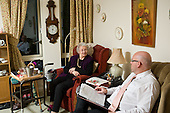 The manager talks to a resident in her room at Waltham House Extra Care, Winksworth, Derbyshire, run by Housing 21.