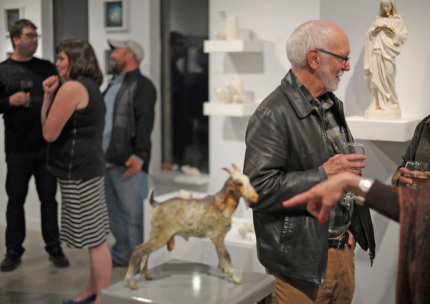 Saskatchewan artist Joe Fafard discusses his work with a guest at the opening of A Tune to Art: Sculpture and Song at the Slate Fine Art Gallery in Regina. The event showcased new works by the Canadian sculptor and a live performance by Fafard's son, musician Joël Fafard, and guitarist Joel Schwartz. MARK TAYLOR FOR THE GLOBE AND MAIL.