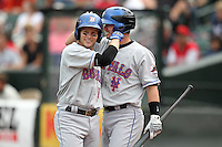 Buffalo Bisons Andy Green is greeted by Russ Adams after hitting a home run during a game vs. the Rochester Red Wings at Frontier Field in Rochester, New York;  September 6, 2010.  Buffalo defeated Rochester 16-1 in the season finale for both teams.  Photo By Mike Janes/Four Seam Images