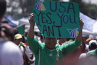 A Mexican fan holds up a sign to United States Men's National team fans outside Azteca stadium before the game.  The United States Men's National Team played Mexico in a CONCACAF World Cup Qualifier match at Azteca Stadium in, Mexico City, Mexico on Wednesday, August 12, 2009.