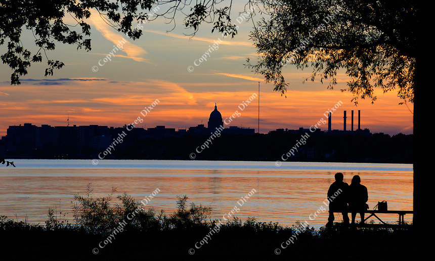 A couple enjoys the view of the State Capitol over Lake Monona from Olbrich Park on Madison's East Side on Friday, October 9, 2015 in Madison, Wisconsin