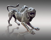 """Etruscan bronce statue of the mythical Chimera known as the  """"Chimera of Arezzo"""" from the St Lorentino Gate of Arezzo, made end of 5th - early 4th century B.C, inv no 1,  National Archaeological Museum Florence, Italy , against grey"""