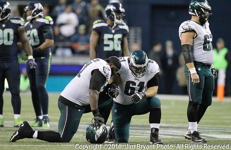 Philadelphia Eagles tackle Jason Peters (71) and  offensive guard Stefen Wisniewski (61) takes a knee during an injury time out at CenturyLink Field in Seattle, Washington on November 20, 2016.  Seahawks beat the Eagles 26-15.  ©2016. Jim Bryant Photo. All Rights Reserved.