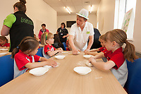 ASDA Newark baker Mark Smith shows the Rainbows how to knead dough