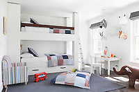 A child's bedroom with a red, white and blue colour scheme for the soft furnishings
