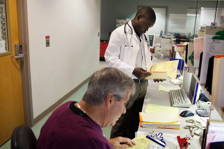 Second year medical student Seth Agiro consults with Dr. David Brown as part of his Early Clinical Contact training in in the O'Bleness Hospital Emergency room in Athens OH Tuesday September 22, 2009
