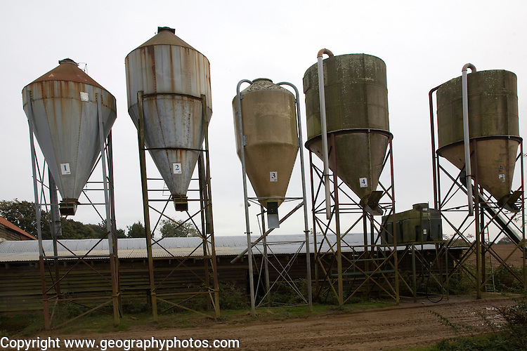 Steel animal feed hoppers on a farm, Sutton, Suffolk, England