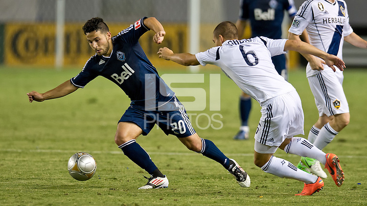 CARSON, CA - June 23, 2012: Vancouver Whitecaps forward Davide Chiumiento (20) during the LA Galaxy vs Vancouver Whitecaps FC match at the Home Depot Center in Carson, California. Final score LA Galaxy 3, Vancouver Whitecaps FC 0.