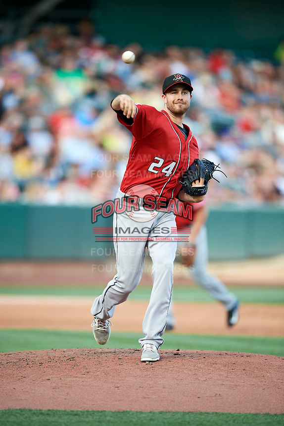 Albuquerque Isotopes starting pitcher Matt Flemer (24) makes a pickoff throw to first base against the Salt Lake Bees in Pacific Coast League action at Smith's Ballpark on June 10, 2017 in Salt Lake City, Utah. The Isotopes defeated the Bees 4-2. (Stephen Smith/Four Seam Images)