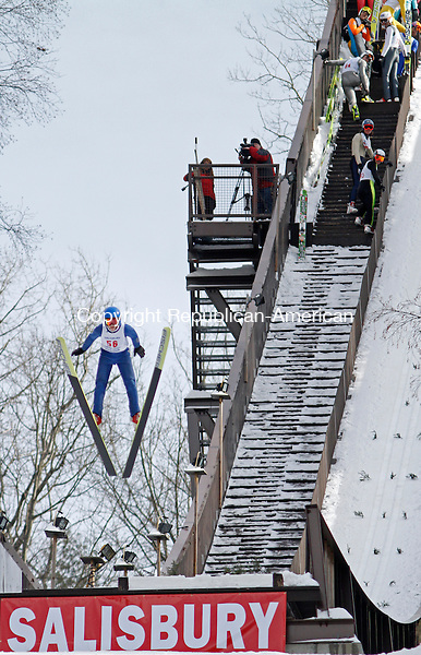 Salisbury, CT-020814MK07 Matt White launches from the ramp as his competitors look on during The Salisbury Invitational Competition on Saturday afternoon at Satre Hill in Salisbury.  Hundreds of spectators came to enjoy the annual event and cheer on their favorite skier. Tyler Smith won the event with an overall score of 222.2. The Eastern U.S. Ski Jumping Championships begin today at 1 p.m.   Michael Kabelka / Republican-American