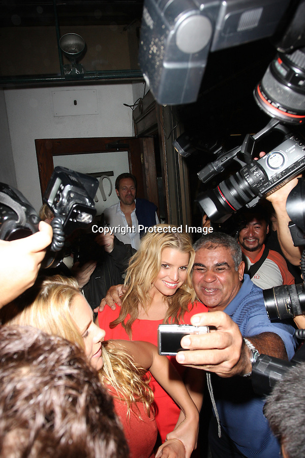 10-1-08.Jessica Simpson leaving Madeo restaurant in beverly hills with Cacee Cobb in a sea of photographers.Yaya, from the Jimmy Kimmel show, is seen taking a pic with.Jessica in the middle of the madness...AbilityFilms@yahoo.com.805-427-3519.www.AbilityFilms.com