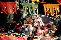 .Statue (believed to be 7th century) of the Hindu god, Vishnu (Narayan), asleep on a bed of snakes at the World Heritage Site at Budhanilkanth, Kathmandu...