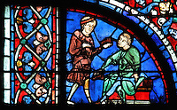 A cobbler handing a shoe to a customer, who is about to try it on, from the donor window of the shoemakers, from the Glorification of the Virgin stained glass window, 13th century, in the nave of Chartres cathedral, Eure-et-Loir, France. Chartres cathedral was built 1194-1250 and is a fine example of Gothic architecture. Most of its windows date from 1205-40 although a few earlier 12th century examples are also intact. It was declared a UNESCO World Heritage Site in 1979. Picture by Manuel Cohen