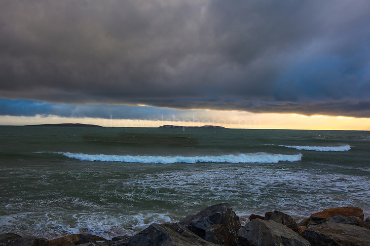 The Saltee Islands seen in stormy weather from Kilmore Quay, Wexford, Ireland