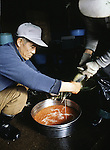 Workers fertilize eggs at  the Towada Salmon Hatchery in Towada, Japan where volunteers catch salmon to fertilize eggs. 30 million young salmon each year are placed in the Oirase River to help in Japan's conservation efforts to replace the salmon taken for food. Most of their work is done during the salmon-spawning season during the fall as the fish begin their annual trek and battle their way through rushing currents and over boulders several miles upstream from the mouth of the river past the hatchery to spawn. (Jim Bryant Photo).