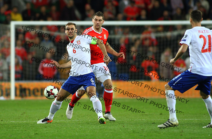 (copyright &amp; photo: STARSPORT)<br /> 12.11.16 World Cup Qualifier -  European Group D - Wales v Serbia -<br /> Branislav Ivanovic of Serbia holds off Sam Vokes of Wales