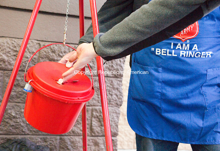 Waterbury, CT- 09 December 2015-120915CM10- Scott Ritchie, a kettle worker with the Salvation Army, collects a donation outside Walmart in Waterbury on Wednesday   Ritchie was collected donations for the Salvation Army, which provides to those in need, among other charitable efforts. Christopher Massa Republican-American