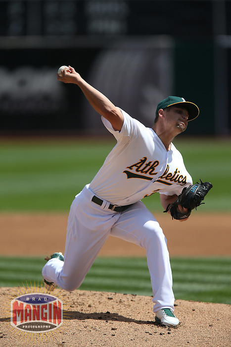OAKLAND, CA - APRIL 9:  Kendall Graveman #31 of the Oakland Athletics pitches against the Texas Rangers during the game at O.co Coliseum on Thursday, April 9, 2015 in Oakland, California. Photo by Brad Mangin