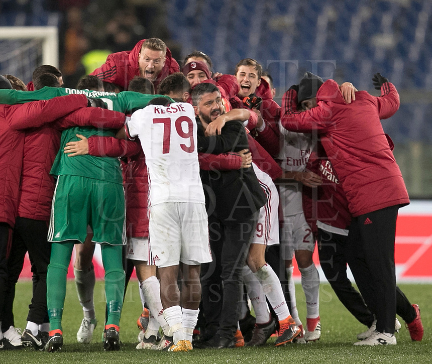 Calcio, Serie A: AS Roma - AC Milan, Roma, stadio Olimpico, 25 febbraio, 2018.<br /> Milan's coach Gennaro Gattuso (c) celebrates with his players after winning 2-0 the Italian Serie A football match between AS Roma and AC Milan at Rome's Olympic stadium, February 28, 2018.<br /> UPDATE IMAGES PRESS/Isabella Bonotto