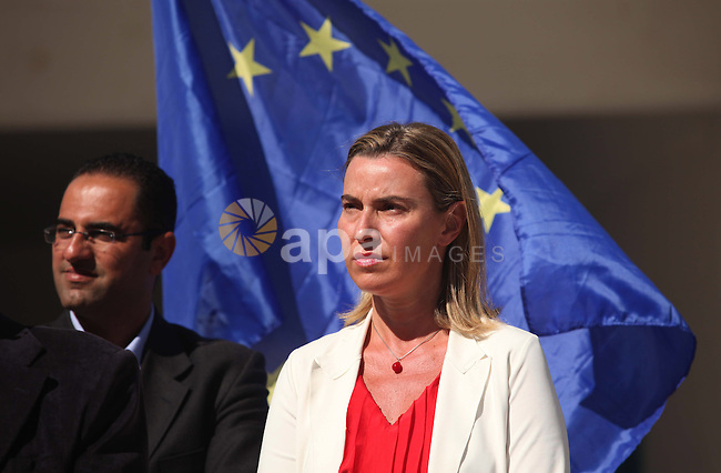 European Union foreign policy chief Federica Mogherini speaks as she visits a UN-run school sheltering Palestinians, whose houses were destroyed during the most recent conflict between Israel and Hamas, in Gaza City November 8, 2014. Photo by Ashraf Amra