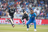 Virat Kolli (India) acts a fielding relay as the New Zealand batsmen take two during India vs New Zealand, ICC World Cup Semi-Final Cricket at Old Trafford on 9th July 2019