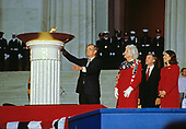 United States President-elect George H.W. Bush participates in the ceremonial candle lighting to conclude the opening ceremony for his inauguration at the Lincoln Memorial in Washington, DC on January 18 1989.  From left to right: President-elect Bush, Barbara Bush, Marilyn Quayle, and US Vice President-elect Dan Quayle.<br />