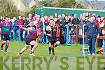 Killarney's Paul O'Sullivan gets away from the tackle of Castlisland'sKieran Downey at O'Dowd park, Tralee on Friday.