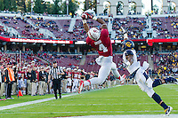 STANFORD, CA - NOVEMBER 23, 2013:  Francis Owusu catches a pass for a touchdown during Stanford's game against Cal. The Cardinal defeated the Bears 63-13.