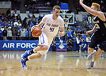 February 28, 2015 - Colorado Springs, Colorado, U.S. -  Air Force center, Zach Moer #41, drives for the basket during an NCAA basketball game between the Utah State Aggies and the Air Force Academy Falcons at Clune Arena, U.S. Air Force Academy, Colorado Springs, Colorado.   Utah State defeats Air Force 74-60.