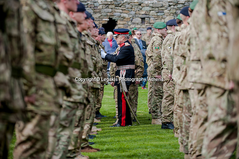 Wednesday 26 March 2014<br /> Pictured: Lord-Lieutenant of Dyfed Robin Lewis presents medals to the troops<br /> Re: 236 Signal Squadron ( part of 14 Signal regiment who are based at Cawdor Barracks in Brawdy Parade through the streets of  St.Davids Pembrokeshire led by Haverfordwest Air Training Corps Band and are then Presented with medals