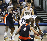 Nevada's Darion Hunt and Bucknell's Bryan Cohen scramble for a loose ball during a second round NIT college basketball game in Reno, Nev. , on Sunday, March 18, 2012. Nevada won 75-67..Photo by Cathleen Allison