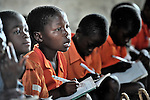 "Gota Dzongololo (second from left), 11, follows as the teacher writes on the blackboard in a primary school class in Chidyamanga, a village in southern Malawi that has been hard hit by drought in recent years, leading to chronic food insecurity, especially during the ""hunger season,"" when farmers are waiting for the harvest."