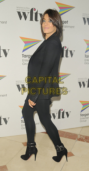 CLAUDIA WINKLEMAN.The Target Women in Film & TV Awards, London Hilton hotel, park Lane, London, England..December 5th, 2008.full length black leggings ankle boots jacket .CAP/CAN.©Can Nguyen/Capital Pictures.