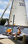 MIDDLEBURY, CT - 22 AUGUST 2015 - 082215JW08.jpg -- Dave Anderson with his 10 year old daughter Brigid Anderson ready their boat for the first race of The Board of Governor's Regatta at Lake Quassapaug Saturday afternoon. Jonathan Wilcox Republican-American