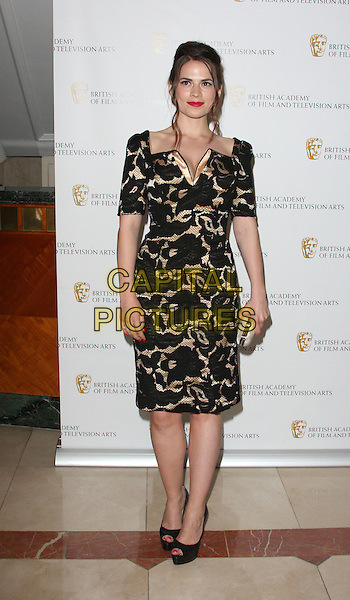 HAYLEY ATWELL .British Academy Television Craft Awards at the Hilton, Park Lane, London, England, UK, May 23rd 2010.BAFTA full length sleeves black gold cream patterned pattern dress peep toe platform shoes .CAP/ROS.©Steve Ross/Capital Pictures