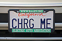 A close up of 'CHRG ME' (Charge Me) license plate. At an Electric Vehicle Rally in Palo Alto, hosted by the Silicon Valley Chapter of the Electric Auto Association. Palo Alto, California, USA