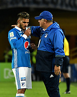 BOGOTA - COLOMBIA - 09 – 05 - 2017: Hugo Gatardi (Der.), asistente tecnico, de Millonarios, da instrucciones a Jacobo Kouffaty (Izq.) jugador de Millonarios, durante partido de la fecha 17 entre Millonarios y Cortulua, por la Liga Aguila I-2017, jugado en el estadio Nemesio Camacho El Campin de la ciudad de Bogota. / Hugo Gatardi (R), coach assistant of Millonarios, gives instructions to Jacobo Kouffaty (L) player of Millonarios, during a match of the date 17th between Millonarios and Cortulua, for the Liga Aguila I-2017 played at the Nemesio Camacho El Campin Stadium in Bogota city, Photo: VizzorImage / Luis Ramirez / Staff.