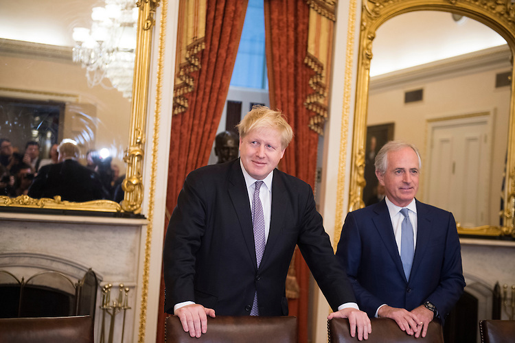 UNITED STATES - JANUARY 09: British Foreign Secretary Boris Johnson, left, meets with Senate Foreign Relations Committee Chairman Bob Corker, R-Tenn., in the Capitol, January 9, 2017. (Photo By Tom Williams/CQ Roll Call)