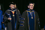 Guillermo Vásquez de Velasco, left, dean of the College of Liberal Arts and Social Sciences, and Gerald P. Koocher, dean of the College of Science and Health, make their way into the arena during the procession Sunday, June 11, 2017, during the DePaul University College of Science and Health and College of Liberal Arts and Social Sciences commencement ceremony at the Allstate Arena in Rosemont, IL. (DePaul University/Jamie Moncrief)