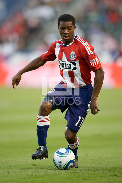 CD Chivas USA midfielder Michael Lahoud (11) looking down moving with the ball. The Philadelphia Union and CD Chivas USA played to 1-1 draw at Home Depot Center stadium in Carson, California on Saturday evening July 3, 2010..