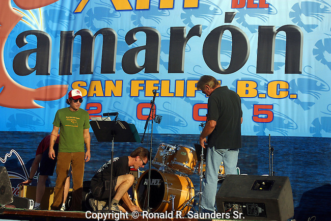 Rock band sets up instruments on stage for the annual shrimp festival