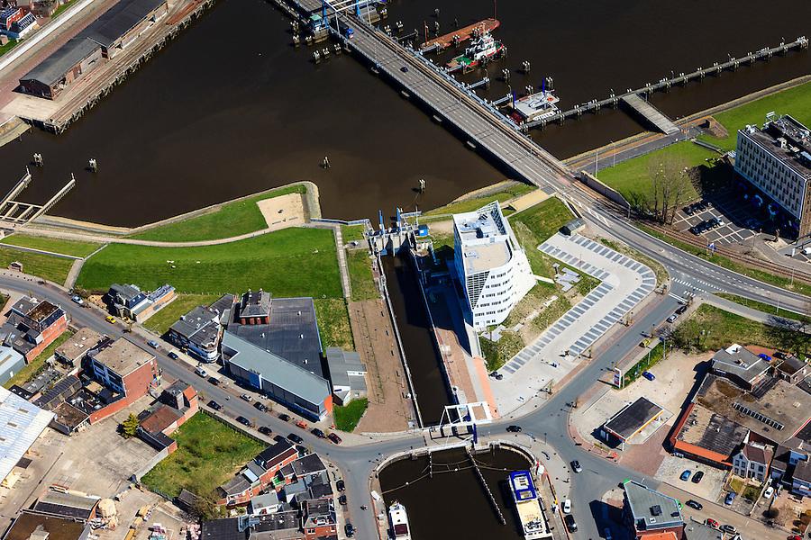Nederland, Groningen, Delfzijl, 01-05-2013; haven Delfzijl met Damsterhaven en sluis Eemskanaal. Zeedijk met coupure.<br /> Delfzijl harbor with shipping lock. Seawall.<br /> luchtfoto (toeslag op standard tarieven);<br /> aerial photo (additional fee required);<br /> copyright foto/photo Siebe Swart