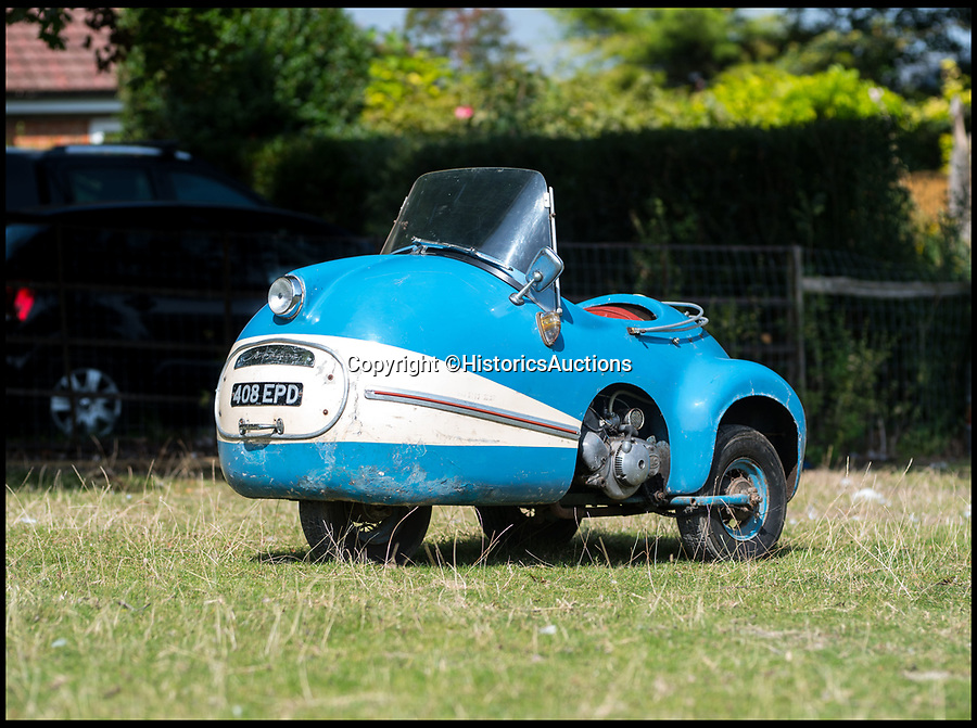 BNPS.co.uk (01202 558833)Pic: HistoricsAuctions/BNPS<br /> <br /> A rare micro-car measuring just 3ft wide has sold for a huge fee of £46,000.<br /> <br /> The blue Brütsch Mopetta dates back to 1953 and is one of only 14 models to be built - although it is now believed less than five survive.<br /> <br /> The car is just 5ft 9.5in long and has a top speed of only 30mph. One year, it is also alleged to have completed the slowest lap time round the circuit at the Goodwood Revival.<br /> <br /> It has three wheels, no roof and a 2-stroke, 50cc engine which is on full show next to one of the two rear wheels. There is room for a single driver who controls the car using a pair of handle bars, rather than a steering wheel.<br /> <br /> There are a few scuffs and a small amount of rust on the bodywork but overall the Mopetta is in good condition and still runs as it should.<br /> <br /> The market for microcars has grown in recent years following the cult following gained by more mass-produced models such as the Peel p50, and the BMW Isetta - better known as 'the bubble car'.