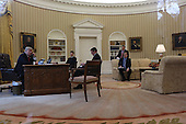 US President Donald Trump speaks with the King of Saudi Arabia, Salman bin Abd al-Aziz Al Saud in the Oval Office of the White House surrounded by  Senior Adviser to the President Jared Kushner (2L), Press Secretary Sean Spicer (R), Security Advisor Michael Flynn, January 29, 2017, Washington, DC.<br /> Credit: Aude Guerrucci / Pool via CNP