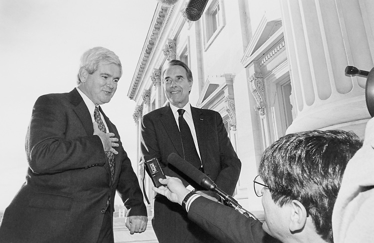 "Soon to be the House Speaker, Senate Majority Leaders Rep. Newton Leroy ""Newt"" Gingrich, R-Ga., and Sen. Robert Joseph ""Bob"" Dole, R-Kans., Minority Leader, pose for a very large group of reporters on balcony outside of Dole office.  After posing, they have meeting with high level staff. November 14, 1994 (Photo by Maureen Keating/CQ Roll Call)"