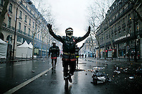 25 March 2004 - Paris, FRA - A firefighter (C) taunts riot police (not visible) off the Place de l'Opera in Paris, 25 March 2004. The firefighters earlier marched through the city to demand that their profession be classified as a dangerous occupation which entails various social security benefits including early retirement. The protest ended violently leaving 2 firefighters and 20 policemen injured.