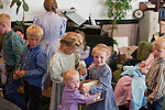 """Aug 10, 2008 -- COLORADO CITY: Children in the Jessop family hand out candy after a prayer service in their living room. The Jessops are polygamists and members of the FLDS. Colorado City and neighboring town of Hildale, UT, are home to the Fundamentalist Church of Jesus Christ of Latter Day Saints (FLDS) which split from the mainstream Church of Jesus Christ of Latter Day Saints (Mormons) after the Mormons banned plural marriage (polygamy) in 1890 so that Utah could gain statehood into the United States. The FLDS Prophet (leader), Warren Jeffs, has been convicted in Utah of """"rape as an accomplice"""" for arranging the marriage of teenage girl to her cousin and is currently on trial for similar, those less serious, charges in Arizona. After Texas child protection authorities raided the Yearning for Zion Ranch, (the FLDS compound in Eldorado, TX) many members of the FLDS community in Colorado City/Hildale fear either Arizona or Utah authorities could raid their homes in the same way. Older members of the community still remember the Short Creek Raid of 1953 when Arizona authorities using National Guard troops, raided the community, arresting the men and placing women and children in """"protective"""" custody. After two years in foster care, the women and children returned to their homes. After the raid, the FLDS Church eliminated any connection to the """"Short Creek raid"""" by renaming their town Colorado City in Arizona and Hildale in Utah.     Photo by Jack Kurtz / ZUMA Press"""