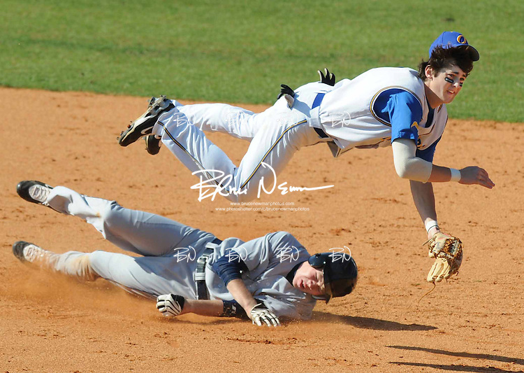 Oxford High's Charley Sullivan is upended while completing a double play against Olive Branch on February 16, 2009 in Oxford, Miss..